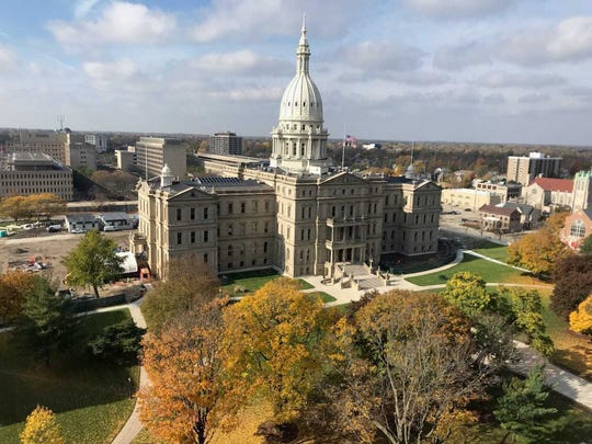 A Democratic group is challenging Michigan's restrictions on transporting voters to the polls and helping people apply for absentee ballots, asking a federal judge to block enforcement of the laws.
