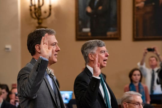 Career Foreign Service officer George Kent, left, and top U.S. diplomat in Ukraine William Taylor, right, are sworn in to testify before the House Intelligence Committee on Capitol Hill in Washington, Wednesday, Nov. 13, 2019.