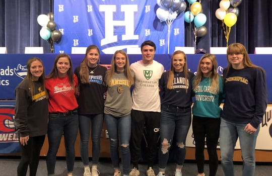 Horseheads seniors who participated in a signing ceremony Nov. 13, 2019 at Horseheads High School, from left: McKenna Woodworth, Abby Packard, Maiah Skakal, Miranda Novitsky, Gavin Elston, Tess Cites, Avery Snyder and Jillian Casey.