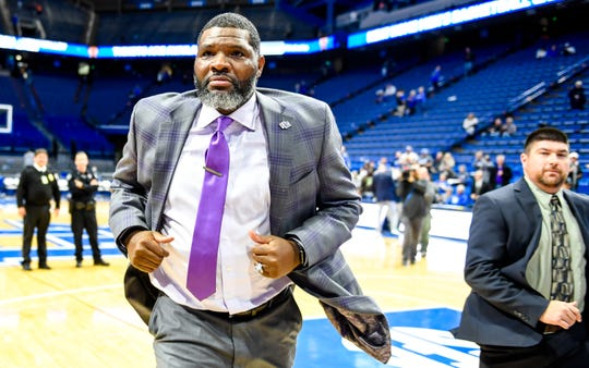 Evansville head coach Walter McCarty runs off the court after defeating the number one ranked Kentucky Wildcats at Rupp Arena in Lexington Tuesday evening, November 12, 2019.