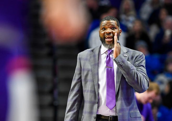 Evansville head coach Walter McCarty yells instructions to his team as the University of Evansville Purple Aces play the number one ranked Kentucky Wildcats at Rupp Arena in Lexington Tuesday evening, November 12, 2019.
