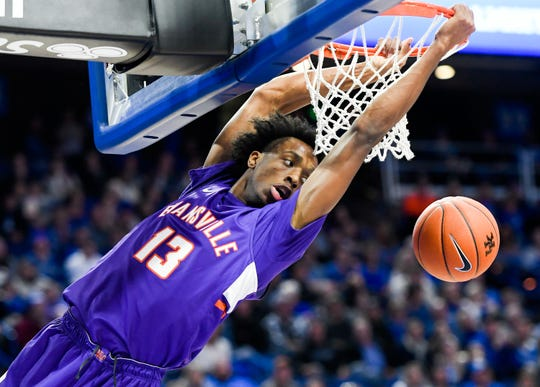 Evansville's DeAndre Williams (13) looks at the ball after scoring a dunk as the University of Evansville Purple Aces play the number one ranked Kentucky Wildcats at Rupp Arena in Lexington Tuesday evening, November 12, 2019.