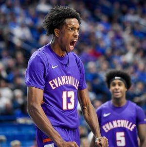 Evansville's DeAndre Williams (13) reacts to a first half basket as the University of Evansville Purple Aces play the number one ranked Kentucky Wildcats at Rupp Arena in Lexington Tuesday evening, November 12, 2019.