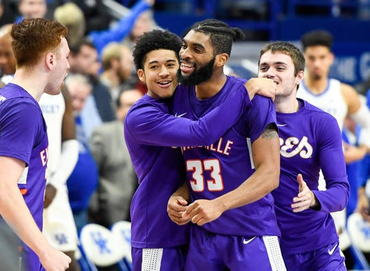The Aces react on court after defeating the number one ranked Kentucky Wildcats 76-74 at Rupp Arena in Lexington Tuesday evening, November 12, 2019.