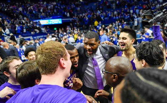 Evansville head coach Walter McCarty talks with his team after defeating the number one ranked Kentucky Wildcats 67-64 at Rupp Arena in Lexington Tuesday evening, November 12, 2019.