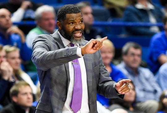 Evansville head coach Walter McCarty directs action on the floor as the University of Evansville Purple Aces play the number one ranked Kentucky Wildcats at Rupp Arena in Lexington Tuesday evening, November 12, 2019.