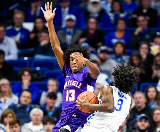 Evansville's DeAndre Williams (13) defends as Kentucky's Tyrese Maxey (3) drives the basket as the University of Evansville Purple Aces play the number one ranked Kentucky Wildcats at Rupp Arena in Lexington Tuesday evening, November 12, 2019.