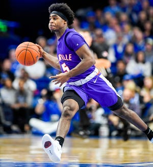 Evansville's Shamar Givance (5) brings the ball down court as the University of Evansville Purple Aces play the number one ranked Kentucky Wildcats at Rupp Arena in Lexington Tuesday evening, November 12, 2019.