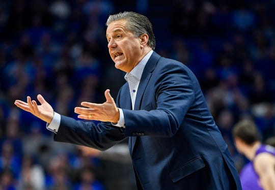 Kentucky head coach John Calipari talks to his team as the University of Evansville Purple Aces play the number one ranked Kentucky Wildcats at Rupp Arena in Lexington Tuesday evening, November 12, 2019.