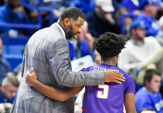 Evansville head coach Walter McCarty talks with Evansville's Shamar Givance (5) as the University of Evansville Purple Aces play the number one ranked Kentucky Wildcats at Rupp Arena in Lexington Tuesday evening, November 12, 2019.