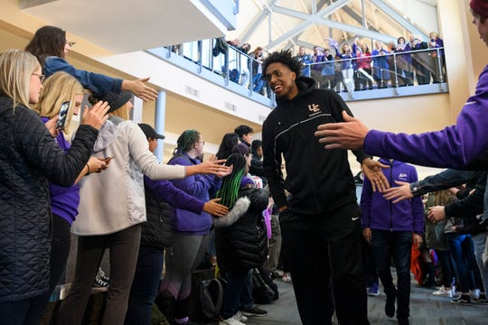 University of Evansville's Deandre Williams walks past cheering fans during a pep rally held for his team inside UE's Ridgway University Center in Evansville, Wednesday, afternoon, Nov. 13, 2019.