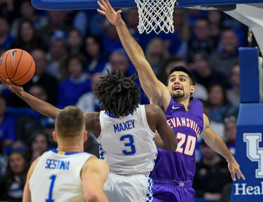 Evansville's Sam Cunliffe (20) defends Kentucky's Tyrese Maxey (3) at the basket as the University of Evansville Purple Aces play the number one ranked Kentucky Wildcats at Rupp Arena in Lexington Tuesday evening, November 12, 2019.