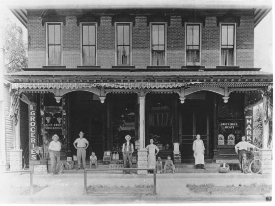 The proprietors of Smith Brothers Groceries and Meats, 1000 Block of Croghan Street in Fremont, pose in front of their store in this photo from the early 1900s.