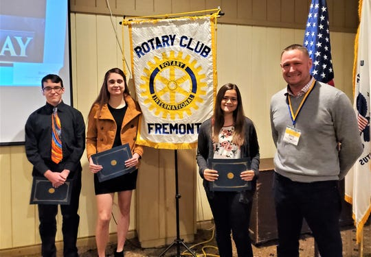 Pictured at the Fremont Rotary meeting, from left to right, are Jesse Layne, Vanguard Career & Tech Center; Abigail Swartzfager, Terra State Community College; Daniella Ortiz, Fremont Ross High School; and Roger Kuns, Fremont Rotary Club President and Marine Corps Veteran.