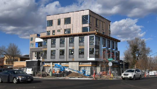 Construction continues on Confluence Fort Collins, a housing development with high-end condos and office space at the corner of Willow Street and Linden Street in downtown Fort Collins, Colo. on Wednesday, Nov. 13, 2019.