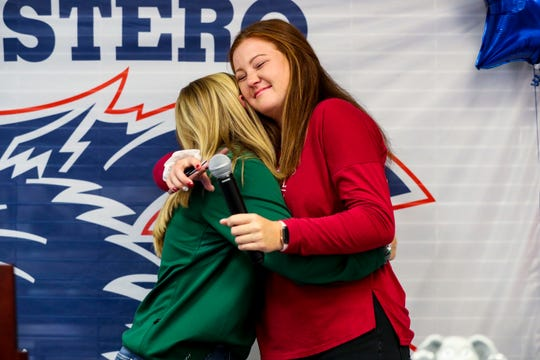 Alex hugs her teammate Lauren after Lauren thanked Alex for being a great friend and teammate and always pushing her to be better. Estero softball players Alex Salter (Alabama) and Lauren Hobbs (Stetson) are officially signed with their Division I schools Wednesday afternoon, November 13, 2019.