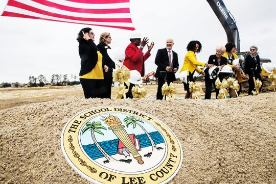 Lee County School's superintendent Greg Adkins, center and Gateway High School principal Neketa Watson are surrounded by members of the Lee County School Board at a groundbreaking ceremony at the new school.