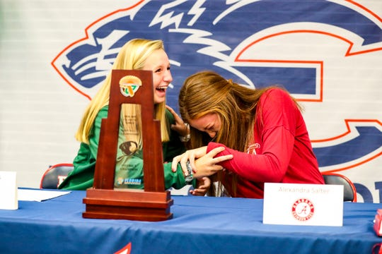 Alex leans on her teammate Lauren after one of their coaches brought tears to her eyes. Estero softball players Alex Salter (Alabama) and Lauren Hobbs (Stetson) are officially signed with their Division I schools Wednesday afternoon, November 13, 2019.