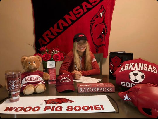 North Fort Myers standout Emilee Hauser signed with the University of Arkansas Wednesday morning.
