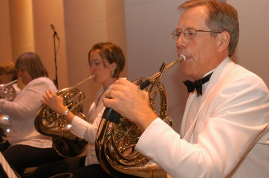 French horn player Tom Schiller has been with Gulf Coast Symphony from the beginning. He played their first concert in May 1996.