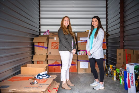 Price Crenshaw, the founder and former executive director, and Annamaria Tormey, the Clemson Hope Adopt a Classroom director, pose for a portrait in a storage unit Tuesday, November 12, 2019, with boxes of toys to be gifted to title 1 elementary school students.