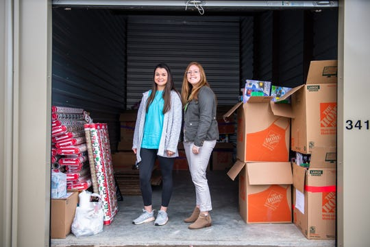 Annamaria Tormey, the Clemson Hope Adopt a Classroom director, and Price Crenshaw, the founder and former executive director, pose for a portrait in a storage unit Tuesday, November 12, 2019, with boxes of toys to be gifted to title 1 elementary school students.