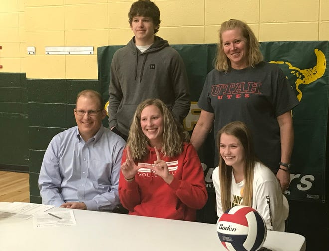 """C.M. Russell senior Allie Olsen (seated, center) makes a big """"U"""" after signing her NCAA Letter-Of-Intent to attend and play volleyball at the University of Utah next fall. Standing behind her are brother Jake and mom Paula, seated left in dad Brian, seated right is friend and teammate Kendal Stoll."""