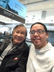 Box Elder Superintendent Jeremy MacDonald, right, had a chance meeting with Olympic gold medalist Billy Mills, left, at the Denver Airport on Monday.