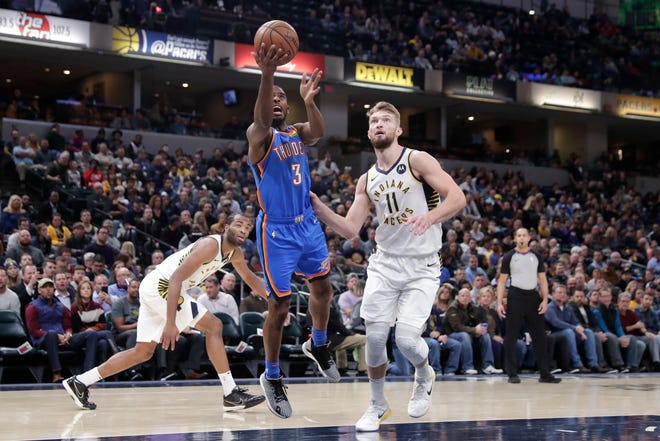 Oklahoma City Thunder guard Chris Paul (3) shoots next to Indiana Pacers forward Domantas Sabonis (11) during the first half of an NBA basketball game in Indianapolis, Tuesday, Nov. 12, 2019.