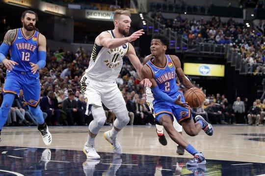 Oklahoma City Thunder guard Shai Gilgeous-Alexander (2) drives on Indiana Pacers forward Domantas Sabonis (11) during the first half of an NBA basketball game in Indianapolis, Tuesday, Nov. 12, 2019.