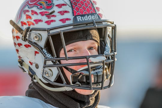 Lincoln Roth practiced with his New Palestine  teammates on Tuesday, a record-breaking cold day in Indiana.