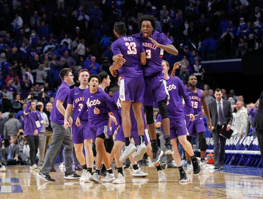 Nov 12, 2019; Lexington, KY, USA; Evansville Purple Aces guard K.J. Riley (33) celebrates with forward DeAndre Williams (13) after defeating the Kentucky Wildcats at Rupp Arena.