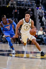 Indiana Pacers guard Malcolm Brogdon (7) drives on Oklahoma City Thunder guard Dennis Schroeder (17) during the second half of an NBA basketball game in Indianapolis, Tuesday, Nov. 12, 2019. The Pacers won 111-85.