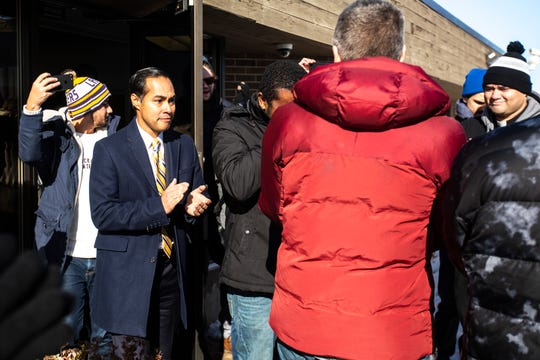 Democratic presidential candidate Julián Castro walks out a meeting with José Reynaldo Robinson Palacios, a Honduran refugee, after a scheduled check-in with ICE, Tuesday, Nov., 12, 2019, in Cedar Rapids, Iowa.