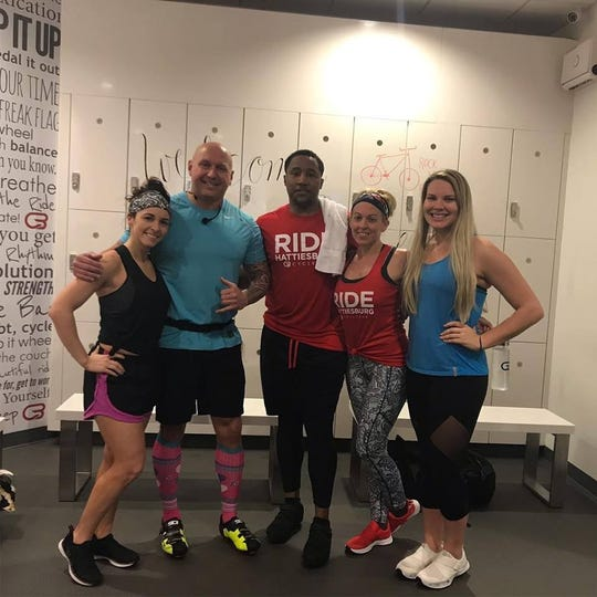 Lt. Col. Joseph Swindle, second from left, started teaching spin classes at CycleBar in Hattiesburg in 2017. Now, he is teaching spin classes to troops while on tour in Bagram, Afghanistan.