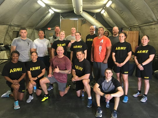 Lt. Col. Joseph Swindle of Hattiesburg, center, front row, is joined by members of a spin class he teaches in a domed-style tent in Bagram, Afghanistan. When not on tour, he teaches spin classes at the CycleBar in Hattiesburg, Miss.