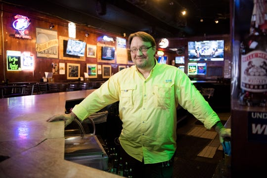 Grier Lequire poses for a photo at The Half Barrel on Cumberland Avenue.