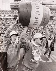 Tennessee managers Dean Roberts, left, and Max Parrott carry traditional Beer Keg after the Vols defeated Kentucky 28-9 on Nov. 23, 1986, at Neyland Stadium.