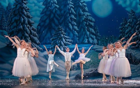 "Snow falls during the Appalachian Ballet's ""Nutcracker."""