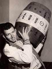 University of Tennessee basketball player Howie Moss holds the traditional Beer Keg on Dec. 1, 1961. Kentucky belatedly sent the keg back to UT after losing to the Vols during the football season.