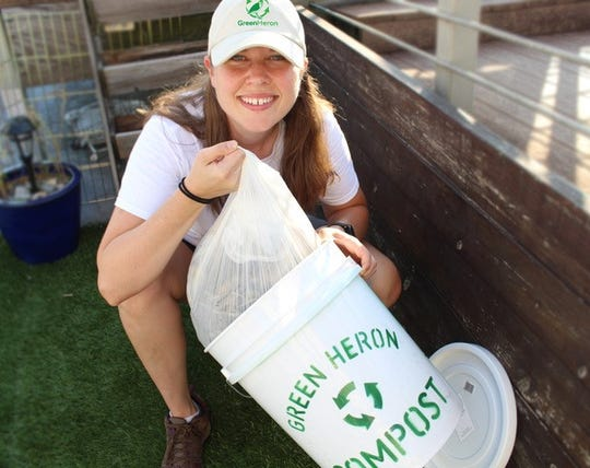 Kat McDearis, founder of Green Heron Compost, displays the bucket she provides her customers, along with biodegradable bin liners. She collects compost from customers in Knoxville, Powell and Corryton.