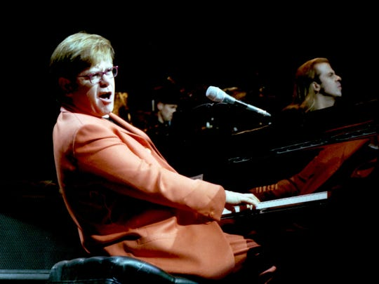 Elton John performs at Thompson-Boling Arena in 1997.