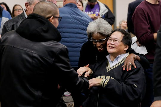West Lafayette council member Norris Wang (R) is congratulated after winning re-election against challenger Austin Bohlin (D), Tuesday, Nov. 5, 2019 at Tippecanoe County Building in Lafayette.