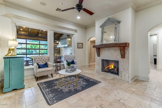7,404 square foot Youngsville mansion has three fireplaces and a backyard oasis, including a pool with a bridge, wading ledge and expansive, lush yard. The home is on the market for $1,497,000