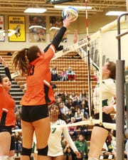 Ceila Cullen of Brighton goes up for the block in Brighton's 3-0 loss to Novi in a regional semifinal volleyball match on Tuesday, Nov. 12, 2019.