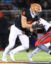 Lineman Luke Stanton is part of a Brighton defense that will try to contain Hudsonville quarterback Ike Irish in a third-round playoff game Friday night.