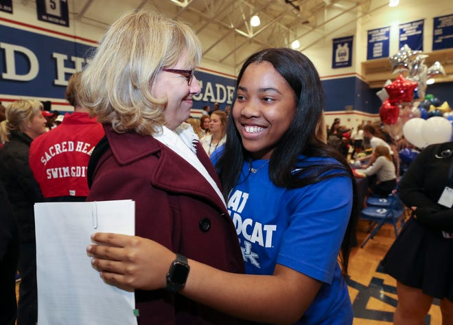 Sacred Heart Academy senior Erin Toller, right, embraced math teacher Laura Clemons on Signing Day for college bound athletes at the school in Louisville, Ky. on Nov. 13, 2019.  Toller signed to play basketball at the University of Kentucky.