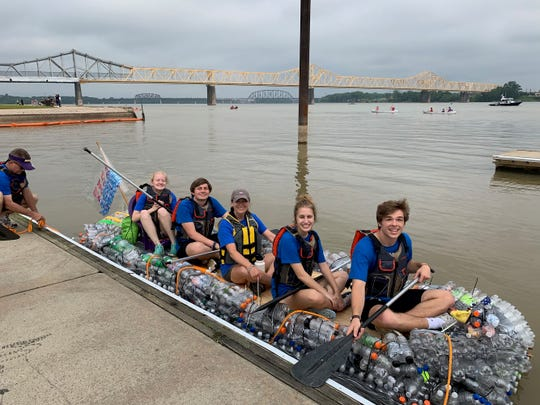 On the boat from left are Male High students Katie Norman, Colby Kinser, their teacher Angela Page and students Haley Pucek and Max Jones
