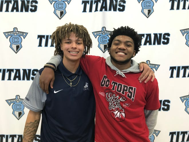 Collins High School's Marcellus Vail, left, and Dayvion McKnight signed with NCAA Division I basketball programs Wednesday. Vail is headed to Samford and McKnight to Western Kentucky.