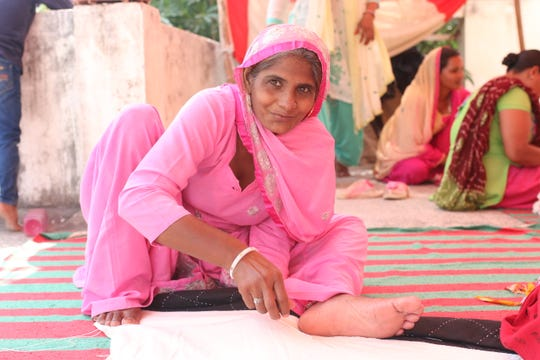 Female worker in India supported through her work with Anchal Project